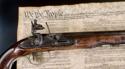 Gun on top of the Constitution